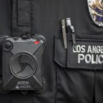 LOS ANGELES, CA - FEBRUARY 18: A Los Angeles police officer wear an AXON body camera during the Immigrants Make America Great March to protest actions being taken by the Trump administration on February 18, 2017 in Los Angeles, California. Protesters are calling for an end to stepped up ICE raids and deportations, and that health care be provided for documented and undocumented people. (Photo by David McNew/Getty Images)